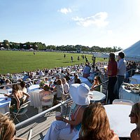 Spectators watching the action from the centerfield Pavilion during a Newport International Polo Series match.