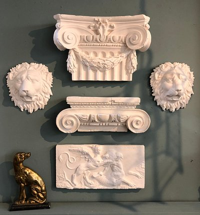 Classical plaster casts and C.19th doorstop.