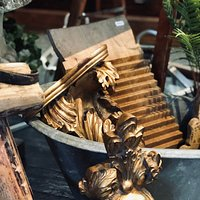 Gilt wood sconces and Italian washboard in a miniature roll top tin bath.