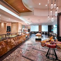 Stop by our new Marriott Café, an inviting space that offers the perfect setting for a light meal or quick bite during your stay in Manila.