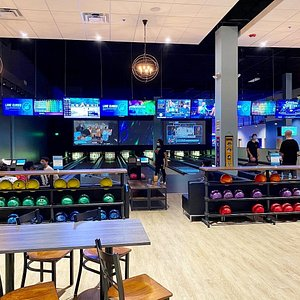 Bowling lanes with lounge seating.