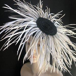 handmade hat studio.  Diane has antique specialty sewing machines to stitch straw braids