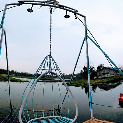 SWING ABOVE WATER IN THIS BEAUTIFUL BLUE SWING.ONE HAS THE FEEL OF FLYING ABOVE WATER.