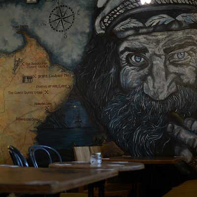 A mural depicting Captain Redman at The Smugglers Rest Seafood Gastrobar, The Harbour Road, Clogherhead.