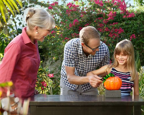 Family learning to blow glass