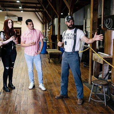 Noah Lirrette (pictured on the right) giving a distillery tour.
