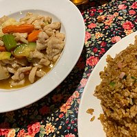 Sizzling Mongolian lamb and chicken with plum sauce with a small bowl of fried rice.