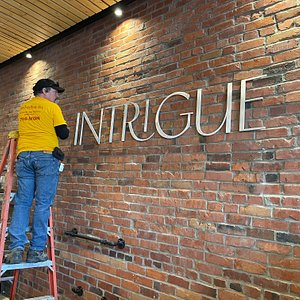 Finishing the installation of our name at our new Main Street location.