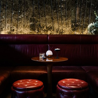 Designed in the colors red and black, the bar is a place for open-minded connoisseurs