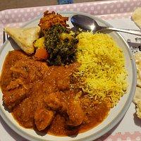 Take away chicken pathia, saag Aloo, pilau rice, veg samosa, and onion bhaji
