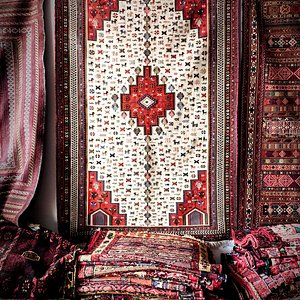 Iranian Zanjan rug surounded by Afghani wonders welcome the visitors in the upper showroom.