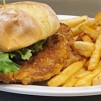 The Jenni. Hand breaded pork sandwich with mayo, lettuce & tomato. Served with choice of side.