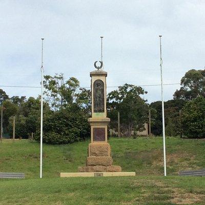 War Memorial with bronze Anzac effigy and laurel crown