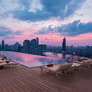 Rooftop swimming pool illuminated by the colours of sunset
