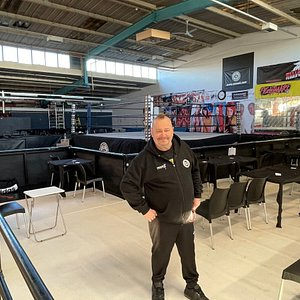 Ricky Knight proudly standing in the main room seating area.