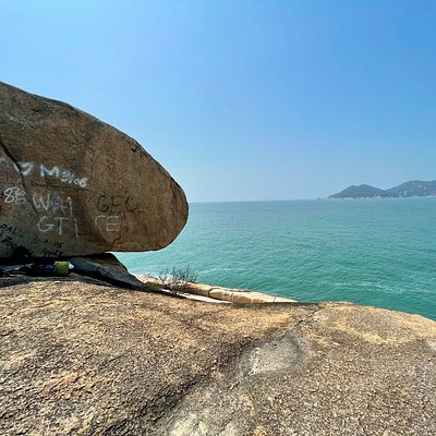 Reclining Rock is the largest of a set of boulder, stacked on the edge of the cliff. This is one of the sights along the Cheung Chau Family Trail that loops around the island.