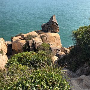 The Rockof the Ringing Bell is one of the dramatic rock features along the coastal Mini Great Wall walking trail on Cheung Chau Island.