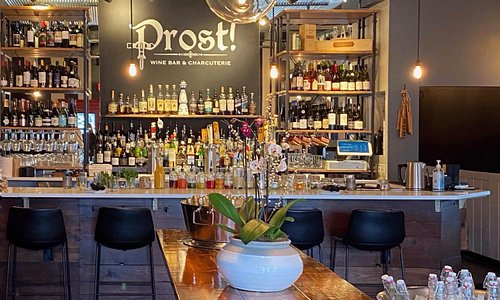 Enjoy Prost Wine Bar & Charcuterie's handcrafted cocktails, brews, and wines on tap in a beautiful atmosphere.