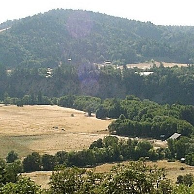 Overview of meadows, farm on right and Eel river far right.