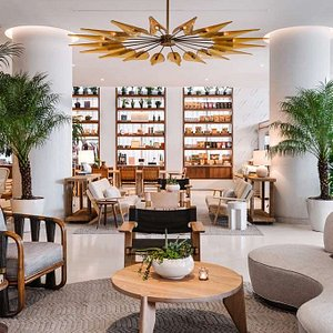 Nautilus's light-filled lobby is popular with locals and travelers alike; it features a curated gift shop of locally produced goods.