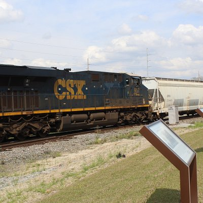 Closeup of a CSX locomotive as it passes the viewing stand of the Cordele Railway Park.