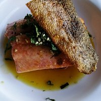 sake poached salmon with crisp salmon chips and shiso leaf salad