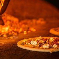 Our woodfire ovens cook pizzas in 90 seconds.