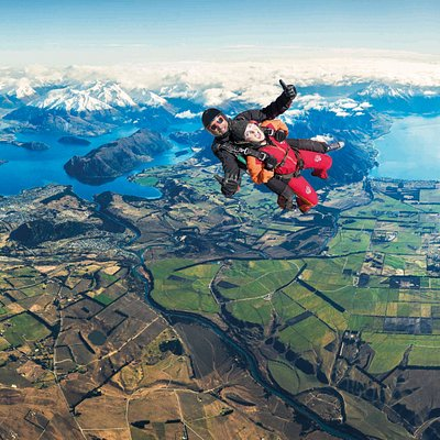 Enjoying the breathtaking views of snow capped mountains, Lake Wanaka and Lake Hawea from 15.000ft