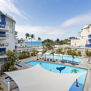 View of guest room balconies and swimming pools