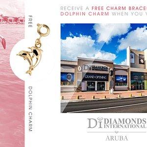 Receive a Free Charm Bracelet & Dolphin Charm When You Visit Diamonds International Aruba.