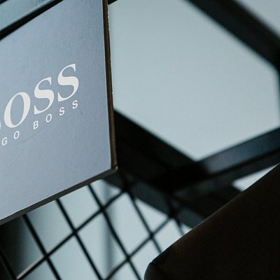 the hugo boss sign on display at mens suit warehouse melbourne stores