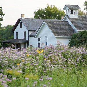 The Schoolhouse, Farmhouse, and Prairie.