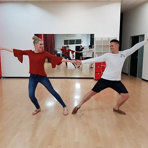 Couple spicing things up with private dance lesson. You don't need a partner to learn to dance.