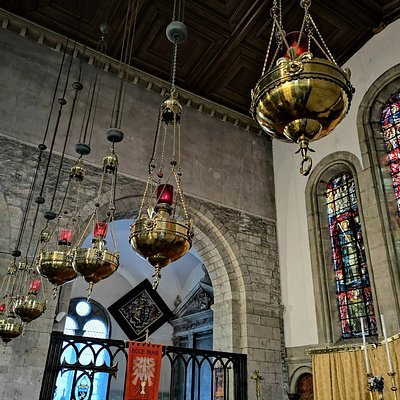 Interior Margam Abbey, Port Talbot. Seven Spirit Lamps above Chancel steps with Powell and Company stained Glass windows in Background.