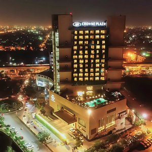 Aerial night view of the Hotel with a city landscape