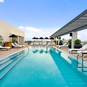 Swimming Pool and Chaise Lounges