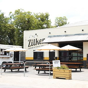 Zilker Brewering Company's spacious  taproom with  plenty of indoor and outdoor seating.  Plus Spicy Boys Fried Chicken onsite all the time.