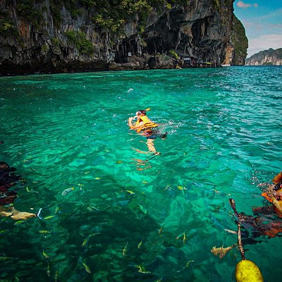 enjoy your snorkeling time a lot of colorful fishes, coral, it very clear water