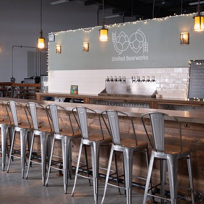 The taproom features a large bar and seating area, with a large glass bay door that opens up on sunny days. During warmer days, enjoy our outdoor patio with tables, chairs and umbrellas so you can relax outside with your Unified Beerworks beverage of choice.