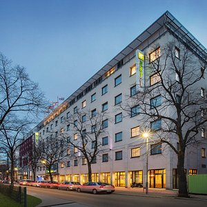 Holiday Inn Express on a broad, tree-lined boulevard in Berlin.