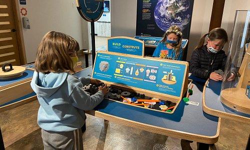 Children play in Sun Earth Universe Exhibit