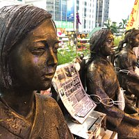 """These simple statues of 3 young women are a terribly moving reminder of the brutal war-time experiences of Chinese and Korean women who were forced into Japanese military brothels as """"comfort women"""" to the Japanese soldiers between 1932 – 45."""