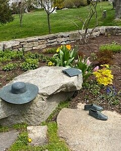 Sculptures of Ms. Bush's sunhat, favorite book, and Keds shoes.