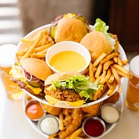 Burger Tower - 2 Cheeseburgers, 2 Chicken Burgers, Mac n Cheese bites, Chips + tenders, cheese bath