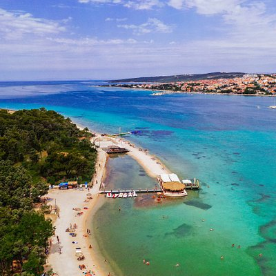 Lokunje- Vrtić Beach is located along the southern edge of the Novalja Bay. It's pebbly, shallow and warm, with a large green belt, which makes it pleasant for vacationing and cooling off during the hot summer days. Photo Credit: Agencija Posada