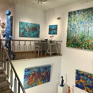 The gallery is over two floors, with the studio upstairs at the back.