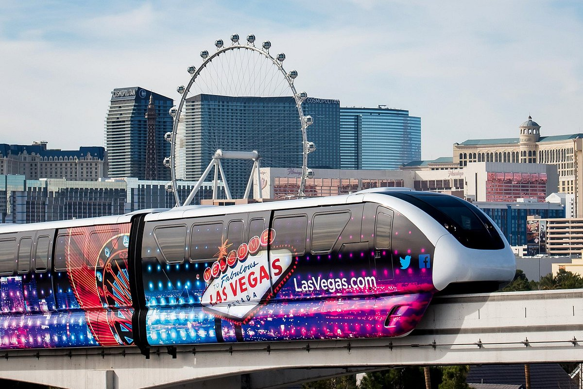 Las Vegas Monorail in foreground with Las Vegas and High Roller observation wheel in background