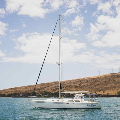 Maui Custom Charters' 42' Catalina MKII departing out of Ma'alaea harbor for a private charter snorkel and sailing trip.