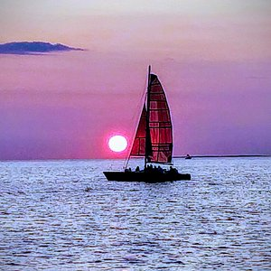 Eleanor's Pearl, one of our catamarans, against a perfect Montauk sunset