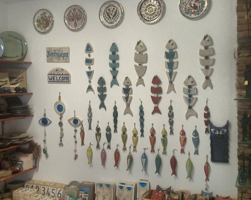 Interion wall decorated with ceramic fish and tradition Rhodian plates on top.